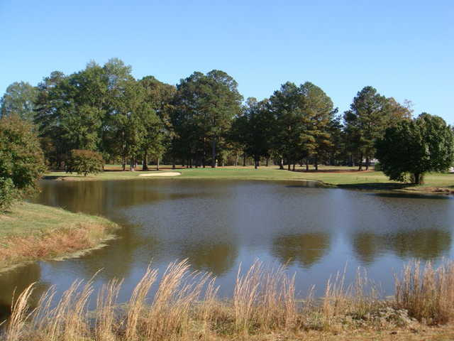 A view over the water of green at Valley Pine Country Club