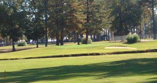 A view of green protected by bunkers at Valley Pine Country Club