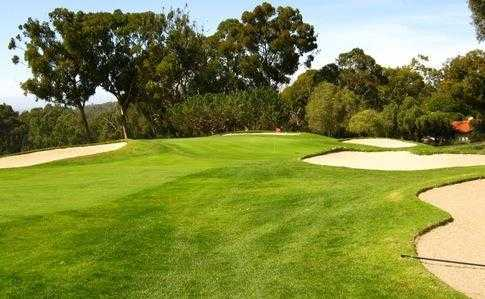 A view of green #11 protected by bunkers (courtesy of Palos Verdes Golf Club)