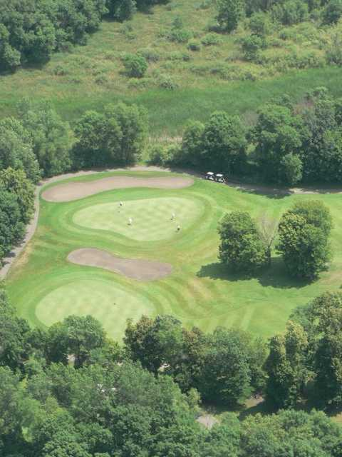 Aerial view of green protected by bunkers at Chomonix Golf Course