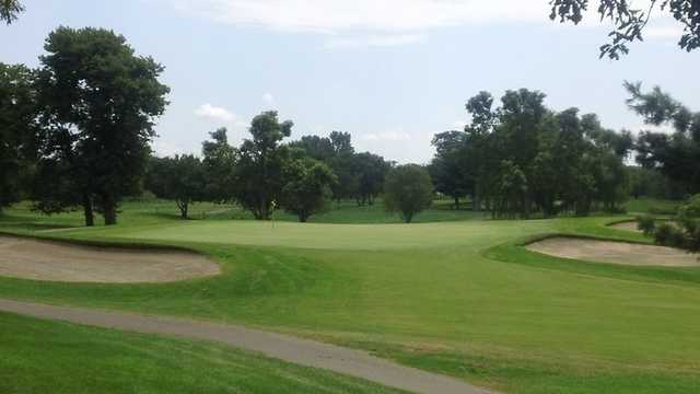 A view of hole #5 flanked by bunkers at Signature Course from Majestic Oaks Golf Club