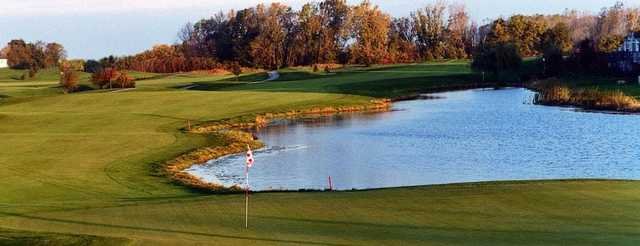 A view of a green with water coming into play at Broken Arrow Golf Club