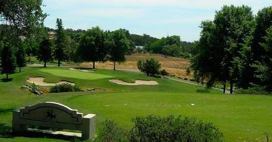 A view of a green protected by bunkers at Rancho Murieta Country Club