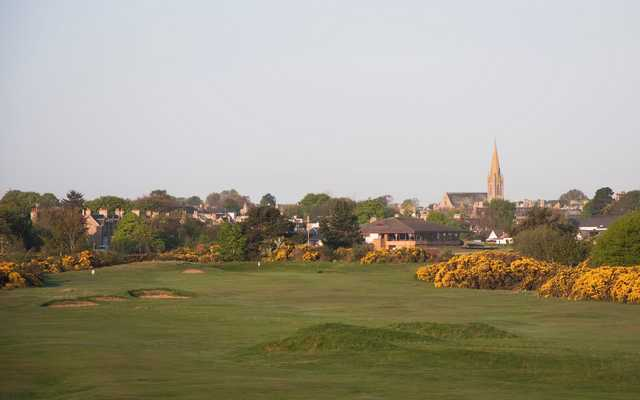 A view of the 5th green from Nairn Dunbar Golf Club with the clubhouse in the background