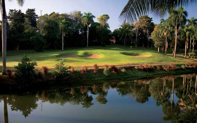 A view over the water of a green protected by bunkers from Sugarcane course at TPC Dorado Beach