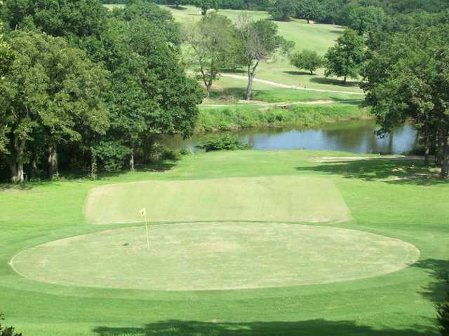 A view of green with water in background at Lakewood Golf Course