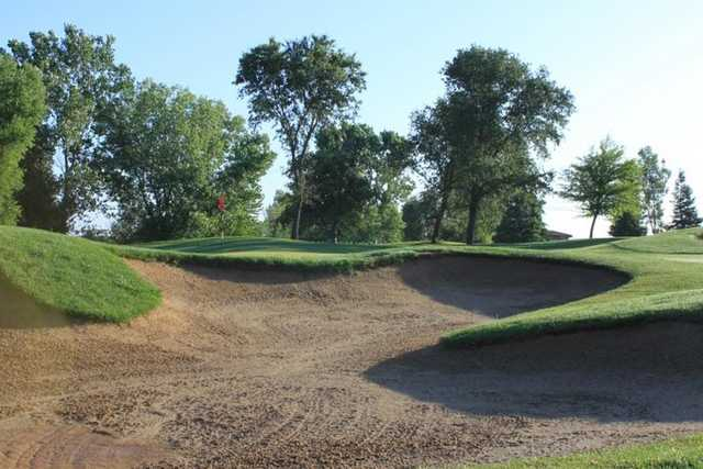 A view of a green protected by bunker at WildHawk Golf Club.