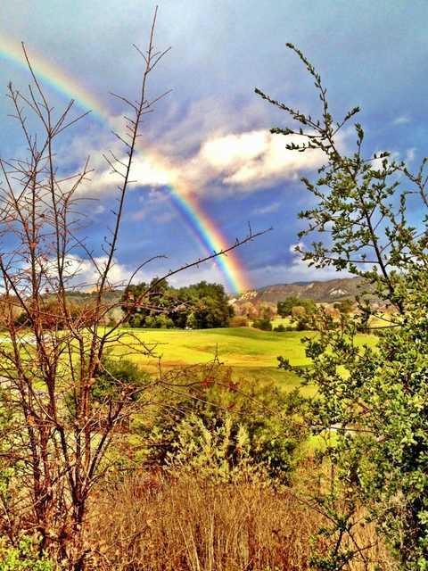Rainbow over hole #10 at Rancho San Marcos Golf Course