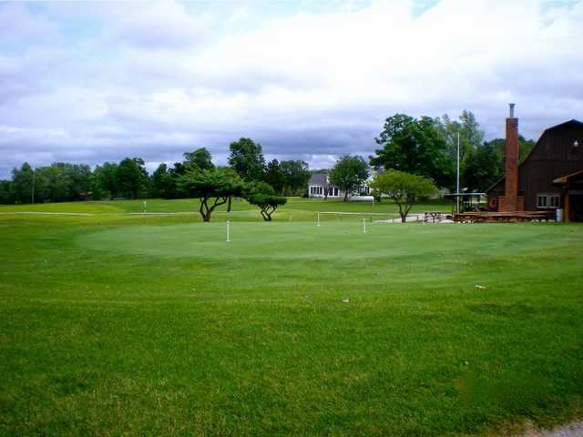 A view of the clubhouse and putting green at Warrenton Golf Course