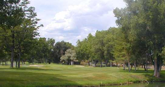 A view over the water of a hole at Columbine Country Club