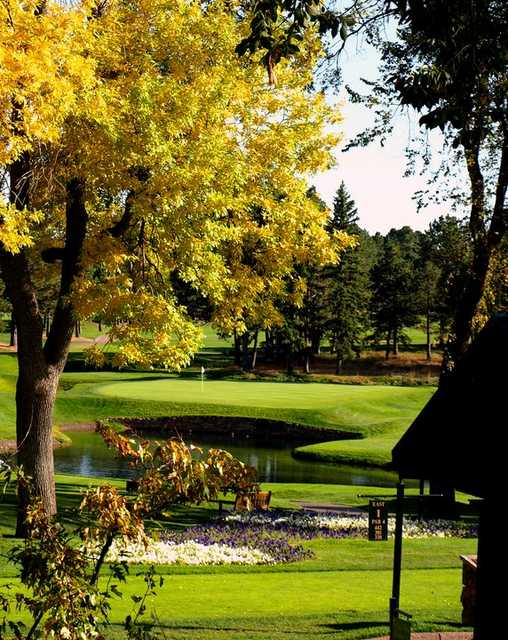 A fall view of a green at Broadmoor Golf Club
