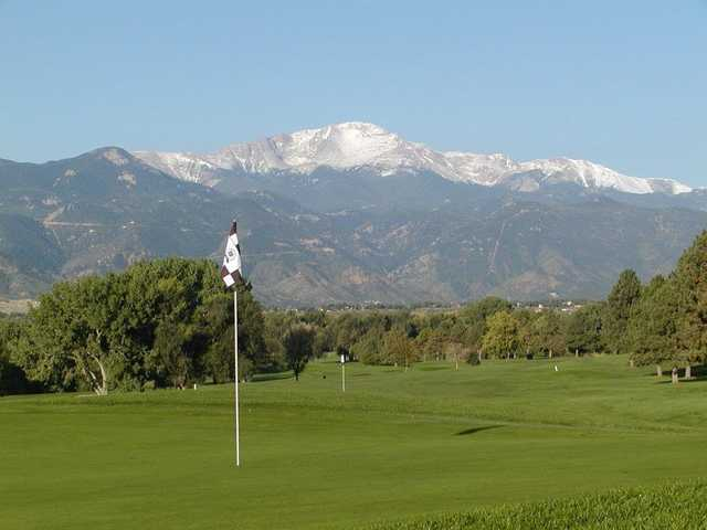 A view of a green with mountains in background from Patty Jewett Golf Club