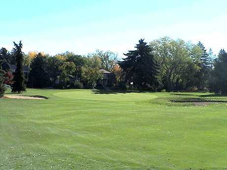 A view of green #4 flanked by bunkers at Denver City Park Golf Course