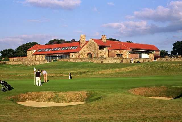 Craigielaw Golf Club's large, stone clubhouse overlooks the golf course and ninth green. (B. Tucker)