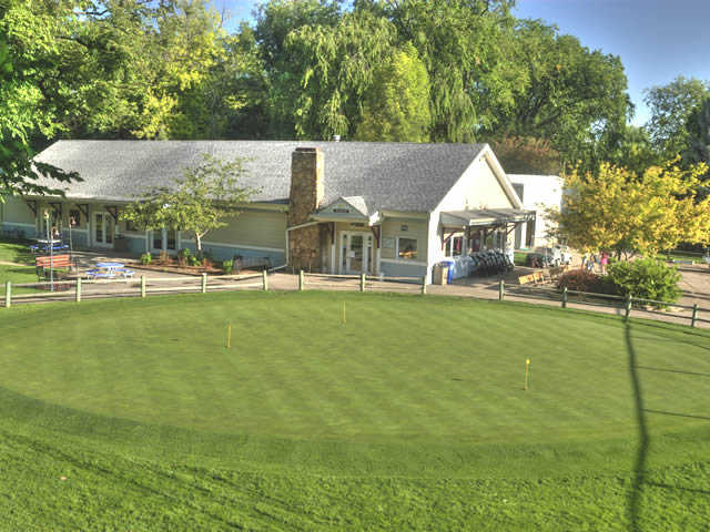 A view of the clubhouse and putting green in foreground at City Park Nine Golf Course