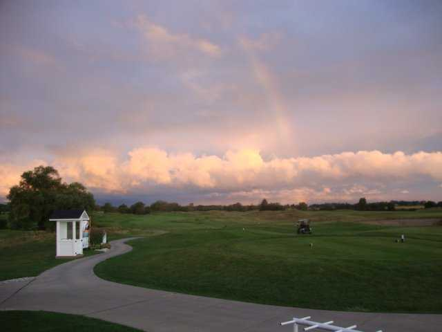 A view of rainbow over a tee at Sawmill Creek Golf Resort & Spa.
