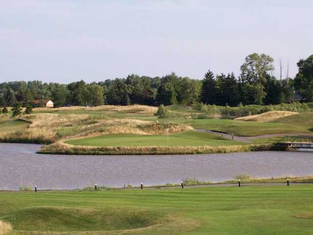 A view of a hole surrounded by water at Sawmill Creek Golf Resort & Spa.