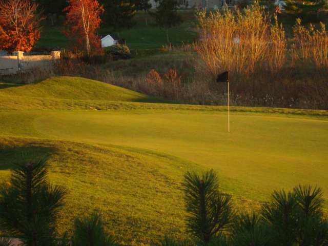 A fall view of a green at Sawmill Creek Golf Resort & Spa.