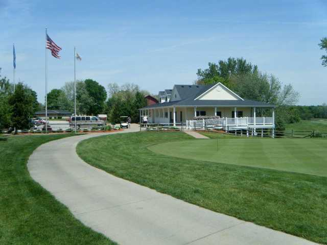 A view of the practice putting green and clubhouse in background at Buffer Park Golf Course