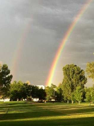 A view of rainbow over Southglenn Country Club