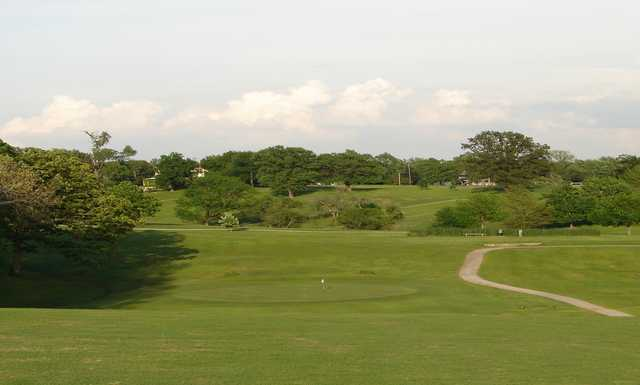 A view of green with narrow path on the right at Helfrich Hills Golf Course