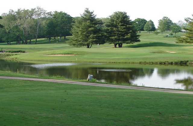 A view over the water of green at Helfrich Hills Golf Course