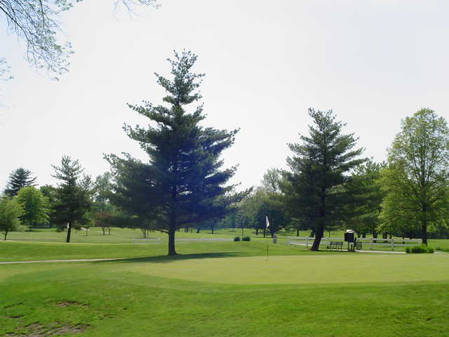 A sunny view of a green at John H. Fendrich Golf Course.