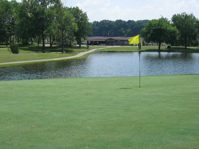 A view of the clubhouse with green in foreground at Ravenswood Golf Club