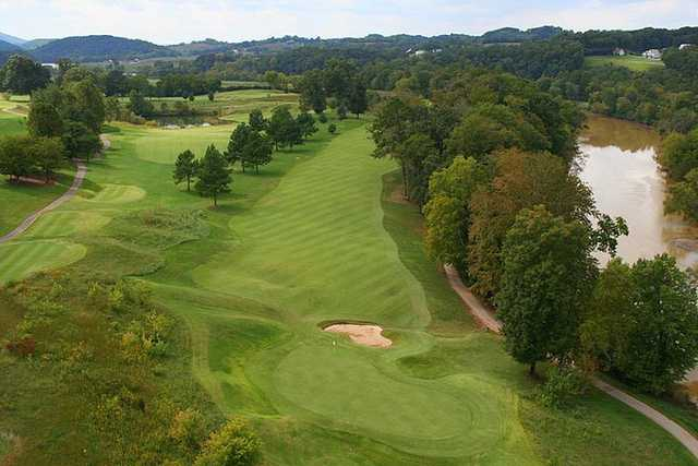 Aerial view of the 14th green framed by oaks at River Islands Golf Club