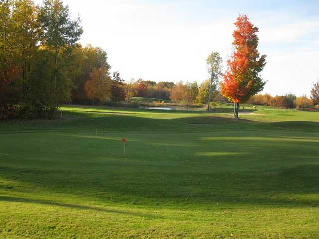 A fall view of the practice area at Quest Golf Club