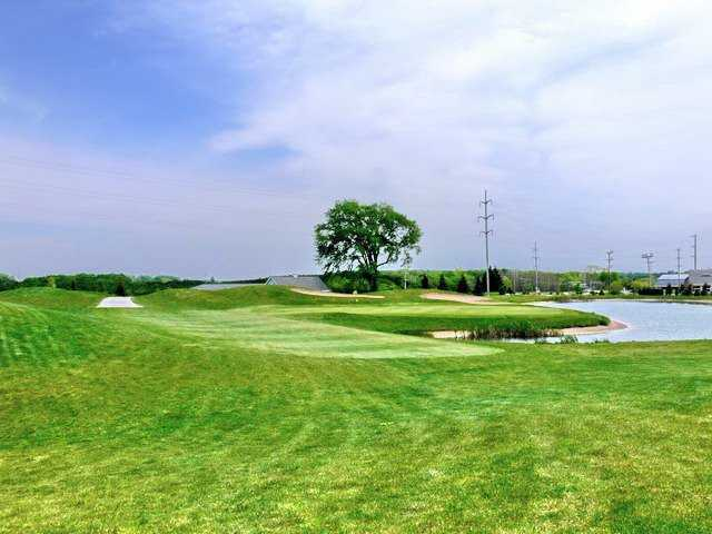 A view from fairway #18 of the green surrounded by water at Crown Golf Course