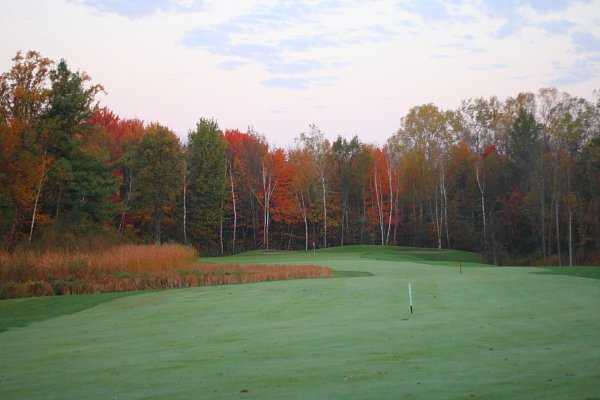 A fall view of green #16 from fairway at Timbers Golf Course
