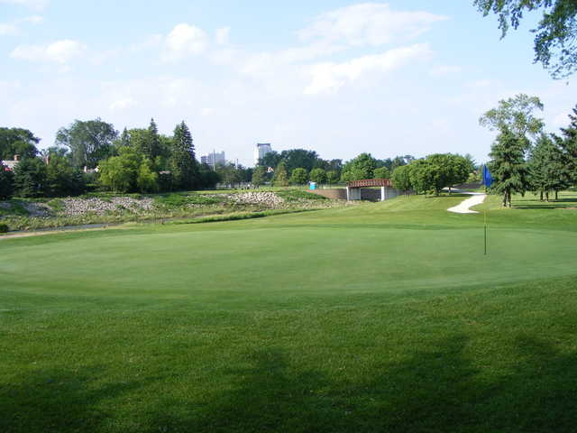 A view of green with bridge in background at Soldiers Memorial Field Golf Course