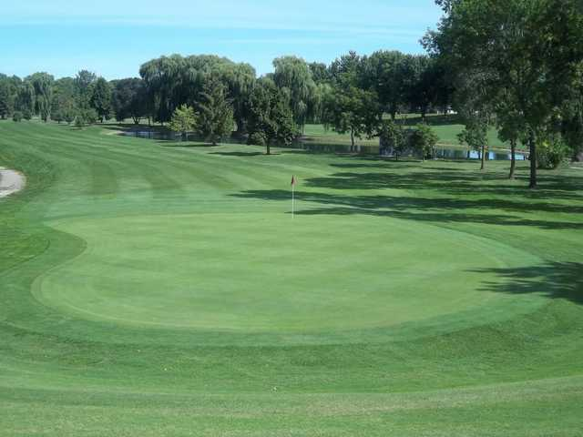 A view of a green and fairway at Green Lea Golf Course