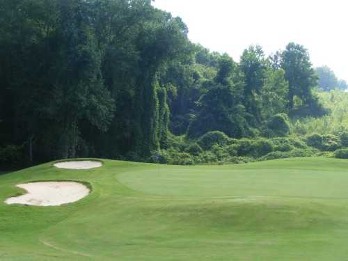 A view of a hole with sand traps on the left at Silo Run Golf Course
