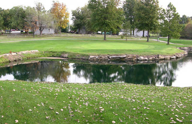 A view of hole #13 surrounded by water at Minor Park Golf Course