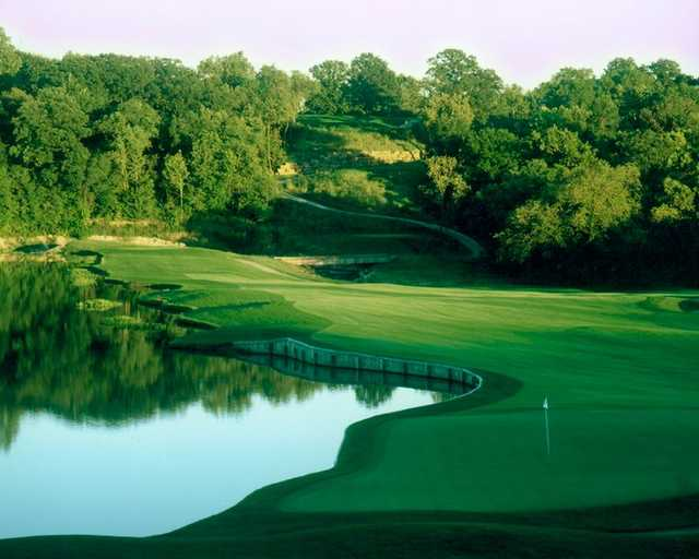 A view of green #9 with water coming into play from left at National Golf Club of Kansas City