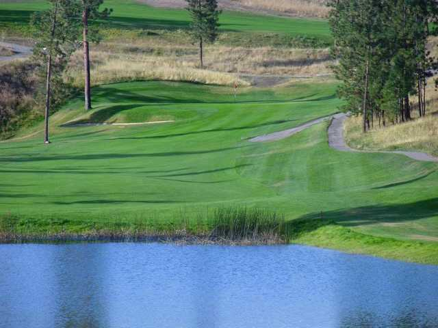 A view over the water of green at Eaglepoint Golf Resort