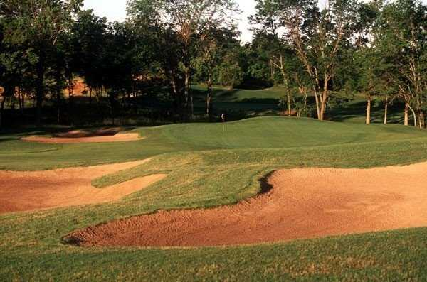 A view of a green protected by sand traps at Shoal Creek Golf Course.