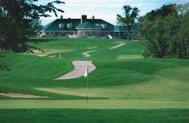 A view of the clubhouse with green in foreground at Tiffany Greens Golf Club