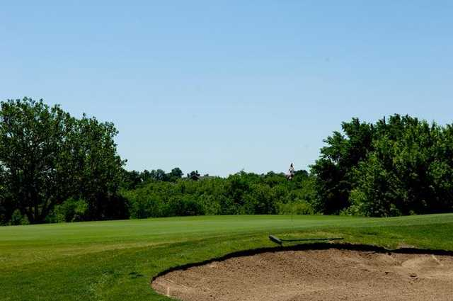A view of the 16th hole protected by bunkers at Cardinal Hill Golf Club