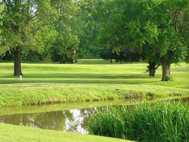 A view over the water of green at Lindsborg Golf Course