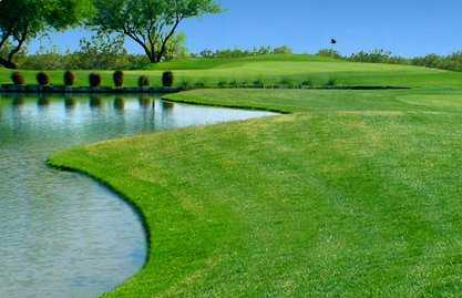 A view of a hole with water on the left side at Apache Creek Golf Club