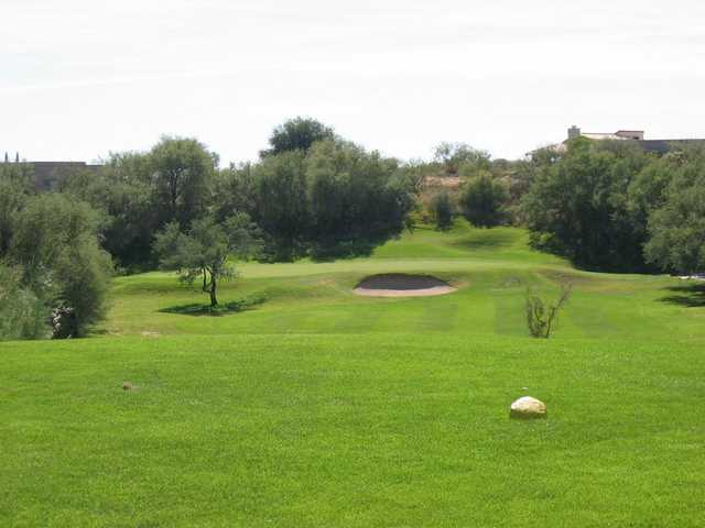 A view of a hole guarded by sand traps at San Ignacio Golf Club