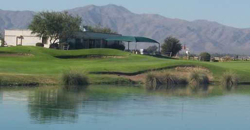 A view over the water of the clubhouse with mountains in background at Falcon Golf Club