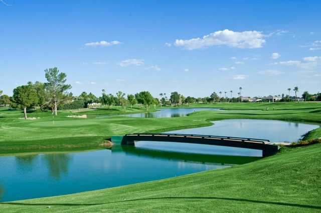 A view of green #17 surrounded by water at Superstition Springs Golf Club