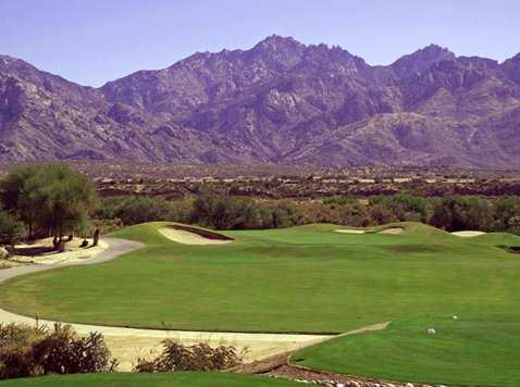 A view from tee with mountains in background at The Views Golf Club at Oro Valley