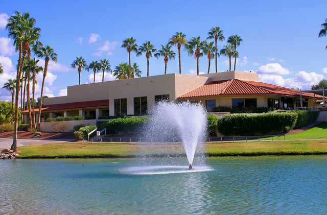 A view of the clubhouse with water fountain in foreground at Lakes Course from Westbrook Village Golf Club