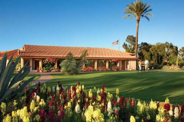 A view of the clubhouse and putting green at 	Rancho de Los Caballeros Golf Club