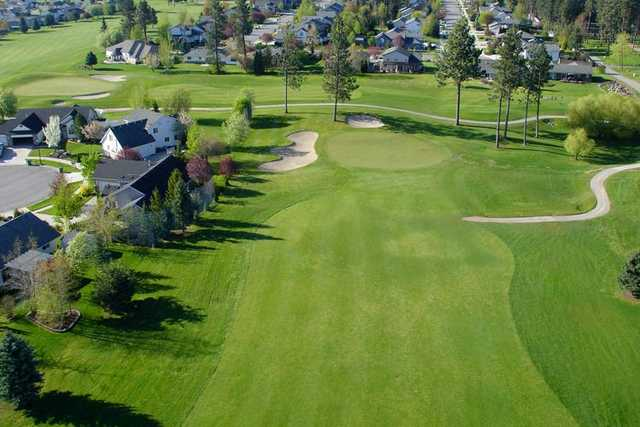 A view of green protected by sand traps at Prairie Falls Golf Club